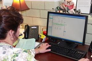 """Mrs. Novak programs the """"Real Life Baby""""."""