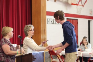 Nathan Kromer receiving one of the Milad and Fanny Abraham Scholarships